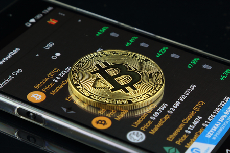 Foto de Physical version of Bitcoin, new virtual money. Conceptual image for worldwide cryptocurrency and digital payment system called the first decentralized digital currency. - Imagen libre de derechos