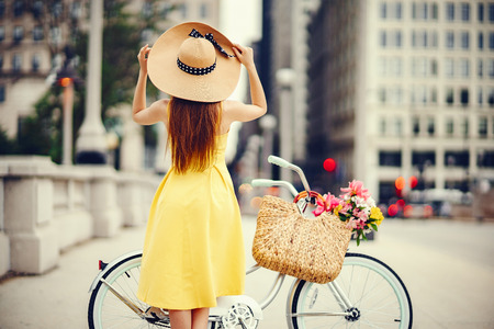 Photo for pretty girl with bicycle - Royalty Free Image