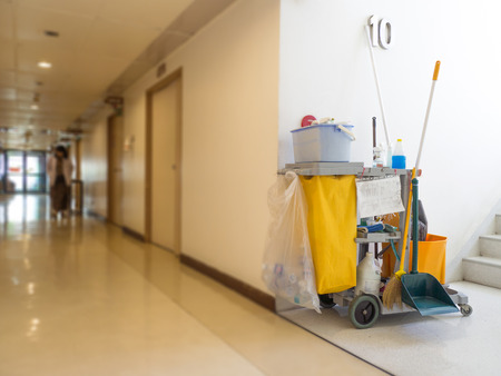 Photo pour Cleaning tools cart wait for maid or cleaner in the hospital. Bucket and set of cleaning equipment in the hospital. Concept of service, worker and equipment for cleaner and health - image libre de droit