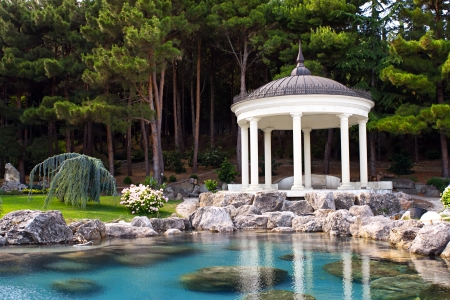 Photo for gazebo by the pond in a beautiful green park - Royalty Free Image