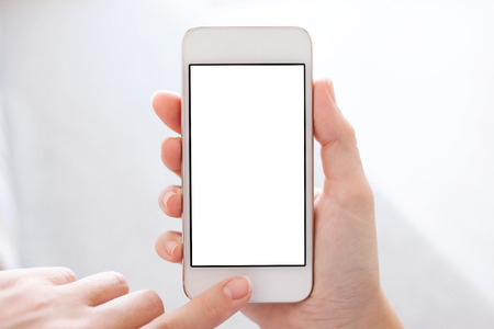 Photo pour phone with isolated screen in female hands - image libre de droit