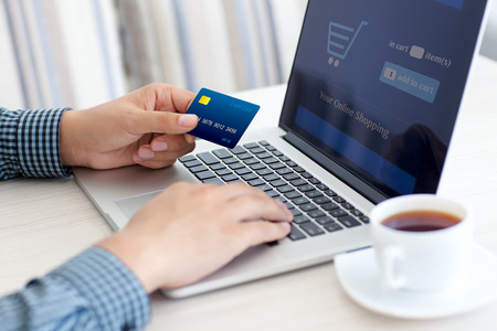 Photo for man doing online shopping with credit card on laptop - Royalty Free Image