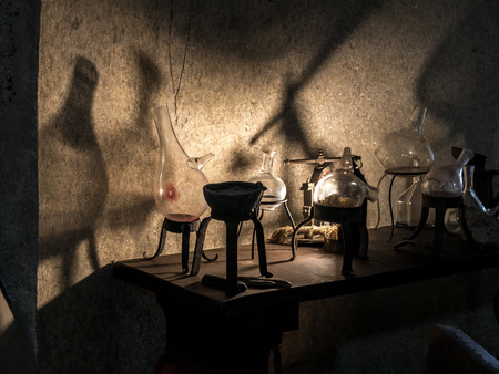 Foto de Ancient alchemist's workshop with instruments and equipment - Imagen libre de derechos