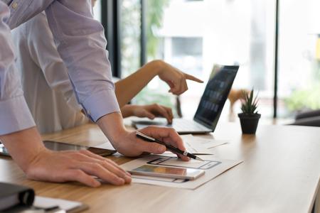 Foto de user experience (UX) designer designing web on smart phone layout. UI teamwork planning mobile application. developer work with business prototype - Imagen libre de derechos