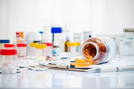 Photo for medicine capsules laid out on a folder - Royalty Free Image