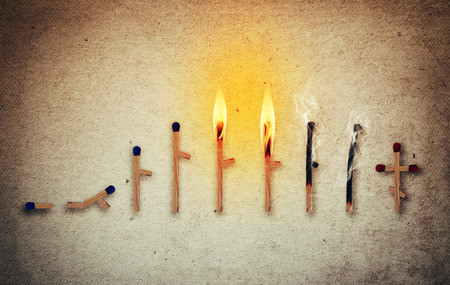 Photo pour Matches symbolizing human life cycle in different ages from birth to death. Stages of development and time passing concept - image libre de droit