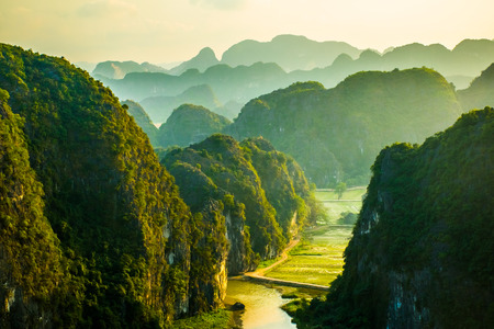 Photo pour Beautiful sunset landscape viewpoint from the top of Mua Cave mountain, Ninh Binh, Tam Coc in Vietnam - image libre de droit