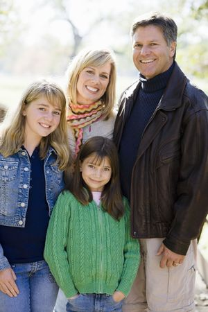 Outdoor Portrait of a Family of Four Standing in a Park
