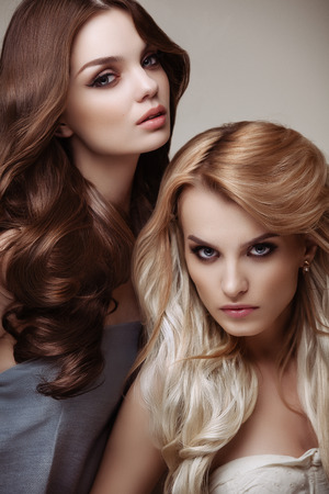Foto de Portrait of Beautiful Women with Long Hair - Imagen libre de derechos