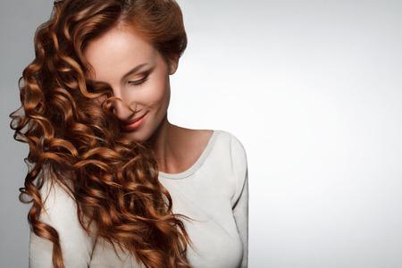 Foto de Beautiful Woman with Curly Long Hair - Imagen libre de derechos
