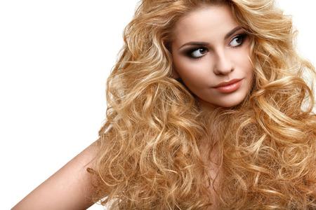 Photo pour Portrait of Beautiful Woman with Long Curly Hair - image libre de droit