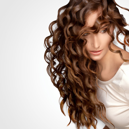 Beautiful Woman with Curly Long Hair