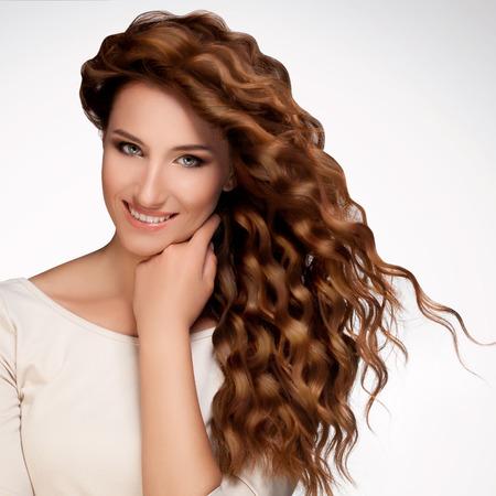 Photo pour Beautiful Woman with Curly Long Hair. - image libre de droit