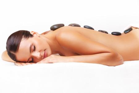 Photo pour Beautiful Woman Getting Spa Hot Stones Massage in Spa Salon. - image libre de droit