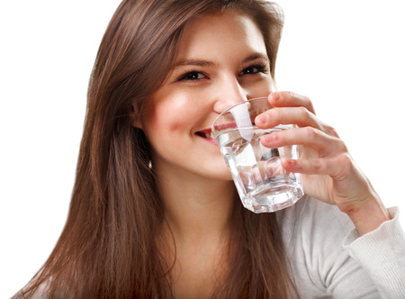 Foto de Smiling Young Woman with glass of Water - Imagen libre de derechos
