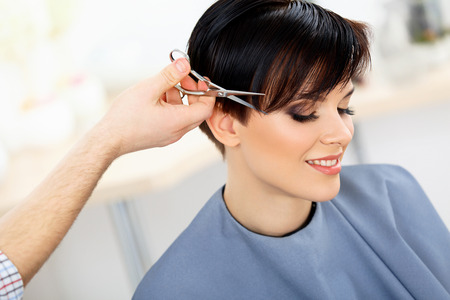 Photo for Hair. Hairdresser Cutting Woman's Hair in Beauty Salon. Haircut - Royalty Free Image