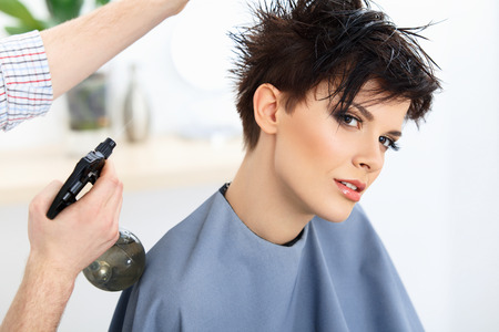 Photo for Brown Hair. The Hairdresser doing Hairstyle in Hair Salon. Haircut. - Royalty Free Image