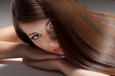 Portrait of Beautiful Woman with smooth gloss long hair