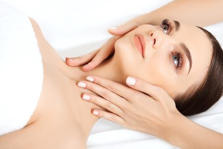 Photo pour Face Massage. Close-up of a Young Woman Getting Spa Treatment. - image libre de droit
