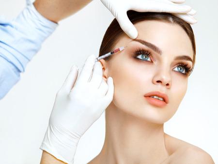 Foto de Beautiful woman gets injections. Cosmetology. Beauty Face - Imagen libre de derechos