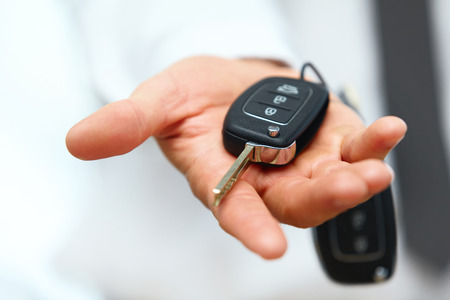 Foto de Car Keys. Seller hand giving keys - Imagen libre de derechos