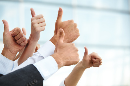 Photo pour Closeup of a Business Thumbs Up - image libre de droit