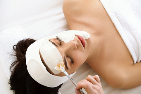 Photo for Spa Mask. Woman in Spa Salon. Face Mask. Facial Clay Mask. Treatment - Royalty Free Image