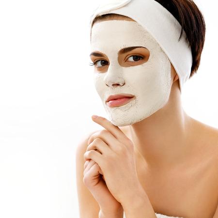 Foto de Spa Mask. Woman in Spa Salon. Face Mask. Facial Clay Mask. Treatment - Imagen libre de derechos