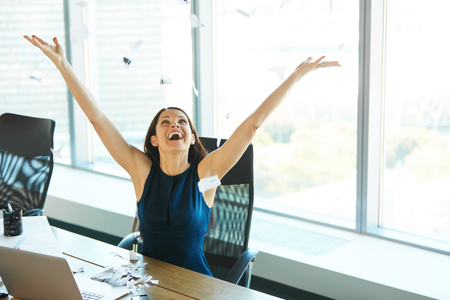 Photo pour Young Business Woman Throwing Paperwork into The Air. Business People - image libre de droit