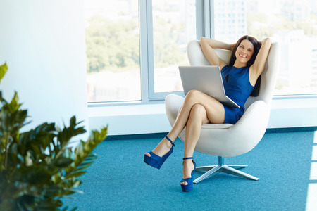 Photo pour Portrait of relaxed business woman in office. Relax and freedom concept - image libre de droit