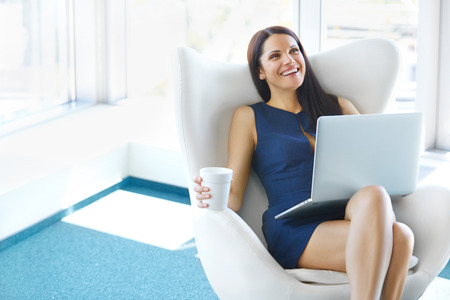Foto de Portrait of relaxed business woman in office. Relax and freedom concept - Imagen libre de derechos