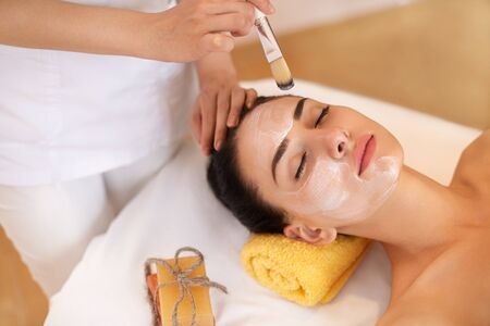 Foto de Face Treatment. Woman in Beauty Salon Gets Marine Mask - Imagen libre de derechos