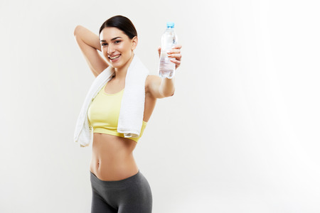 Photo pour Athletic Girl With a Bottle of Water - image libre de droit