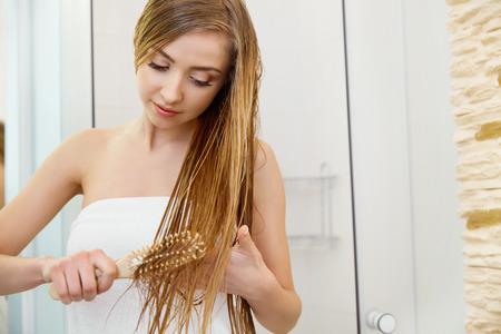 Beautiful Blond Brushing Her Wet Hair