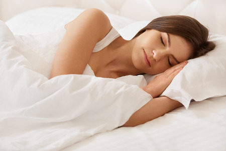 Photo pour Young Beautiful Woman Sleeping on Bed - image libre de droit