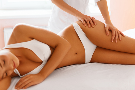 Photo pour Body Care. Spa Massage Treatment. Close-up Of Beautiful Young Healthy Caucasian Woman Getting Anti-cellulite Massaging Procedure. Body Contouring Treatment. Body Care, Skin Care, Wellbeing, Wellness Concept. - image libre de droit
