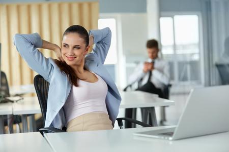 Photo pour Relaxed Young Businesswoman Feeling Positive - image libre de droit