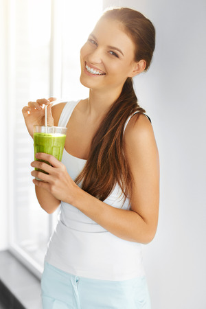 Photo for Organic Food. Healthy Eating Woman Drinking Fresh Raw Green Detox Vegetable Juice. Healthy Lifestyle, Vegetarian Meal. Drink Smoothie. Nutrition Concept. Diet. - Royalty Free Image