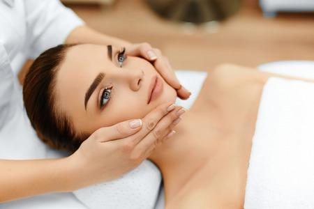 Foto de Skin And Body Care. Close-up Of A Young Woman Getting Spa Treatment At Beauty Salon. Spa Face Massage. Facial Beauty Treatment. Spa Salon. - Imagen libre de derechos