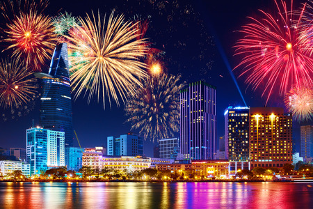 Photo pour Celebration. Skyline with fireworks light up sky over business district in Ho Chi Minh City ( Saigon ), Vietnam. Beautiful night view cityscape, scenic urban landscape. Holidays, celebrating New Year. - image libre de droit
