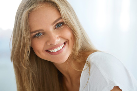 Foto für Beautiful Woman Smiling. Portrait Of Attractive Happy Healthy Girl With Perfect Smile, White Teeth, Blonde Hair And Fresh Face Smiling Indoors. Beauty And Health Concept. High Resolution Image - Lizenzfreies Bild