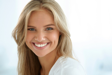 Photo for Beauty Woman Portrait. Closeup Of Beautiful Happy Girl With Perfect Smile, White Teeth Smiling At Camera. Attractive Healthy Young Female With Fresh Natural Face Makeup Indoors. High Resolution Image - Royalty Free Image