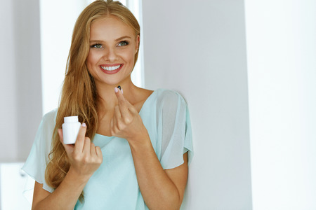 Photo for Woman Taking Medicine. Beautiful Smiling Girl Taking Medication, Holding Bottle With Pills In Hand. Healthy Happy Female Eating Pill. Vitamins And Supplements, Diet Nutrition Concept. High Resolution - Royalty Free Image