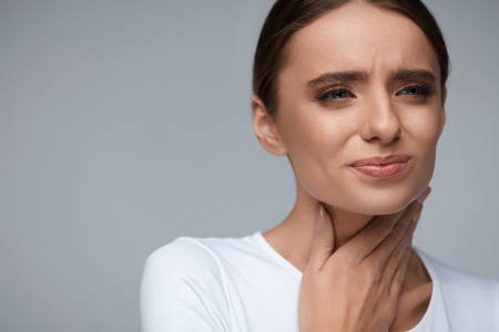 Photo for Throat Pain. Beautiful Woman Having Sore Throat, Feeling Sick. Unhappy Ill Female Suffering From Painful Swallowing, Strong Pain In Throat, Holding Hand On Her Neck. Health Concept. High Resolution - Royalty Free Image