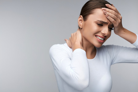 Photo pour Pain And Fever. Beautiful Young Woman Feeling Sick And Tired. Female Having Headache And High Temperature. Girl Suffering From Painful Body Aches, Neck Pain, Holding Hand On Forehead. High Resolution - image libre de droit