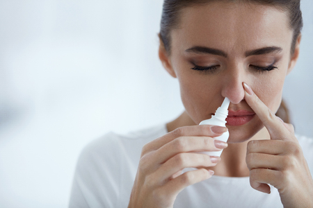 Photo for Cold. Portrait Of Beautiful Young Woman Sniffing Nasal Spray Closing One Nostril. Closeup Of Female Feeling Sick With Running Nose Using Sinus Medication For Blocked Nose. Healthcare. High Resolution - Royalty Free Image