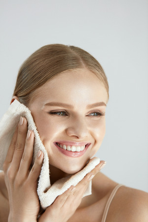 Photo pour Face Washing. Closeup Of Happy Woman Drying Skin With Towel. High Resolution - image libre de droit