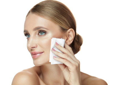 Photo for Face Care. Portrait Of Attractive Smiling Young Woman Removing Makeup Using Wet Wipes. Closeup Beautiful Happy Girl With Natural Make-up Cleaning Healthy Soft Skin. Beauty Cosmetics. High Resolution - Royalty Free Image