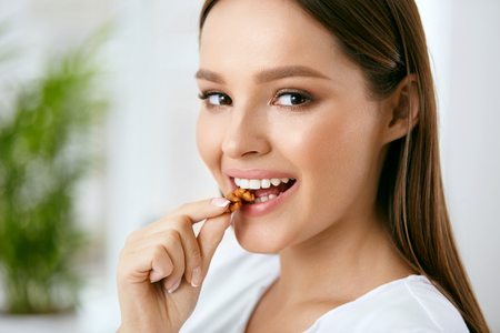 Photo for Woman Eating Healthy Diet Food In Kitchen - Royalty Free Image