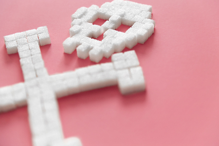 Photo pour White Sugar Cubes In Form Of Skull. Close Up Of Refined Sugar On Pink Background. Deadly Sugar Addiction. Diabetes And Death Concept. High Quality - image libre de droit